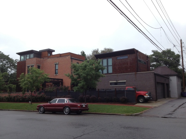 A cool house with a nice Rakish Jag out front on the street
