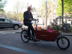 man and daughter on bike