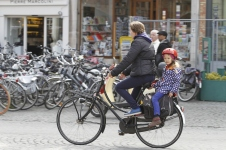 kid riding on back rack